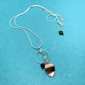 oval copper with silver circular necklace