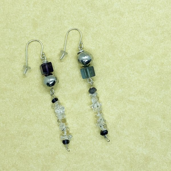Pebble collection earrings with fluoride